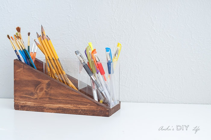 View of the completed modern diy pencil holder with pens and paintbrushes