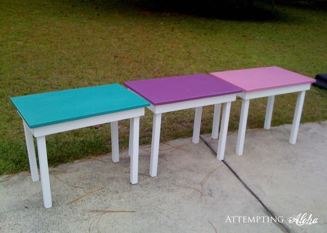 3 Colorful kids tables in backyard