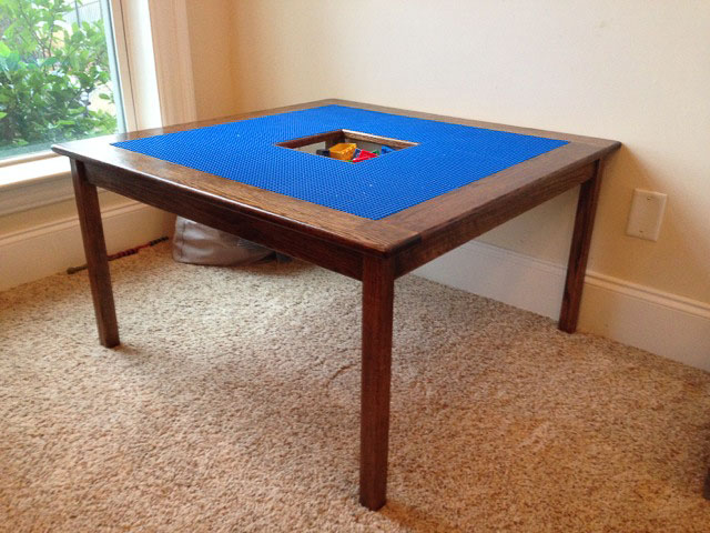 DIY lego table with blue lego plates in a room