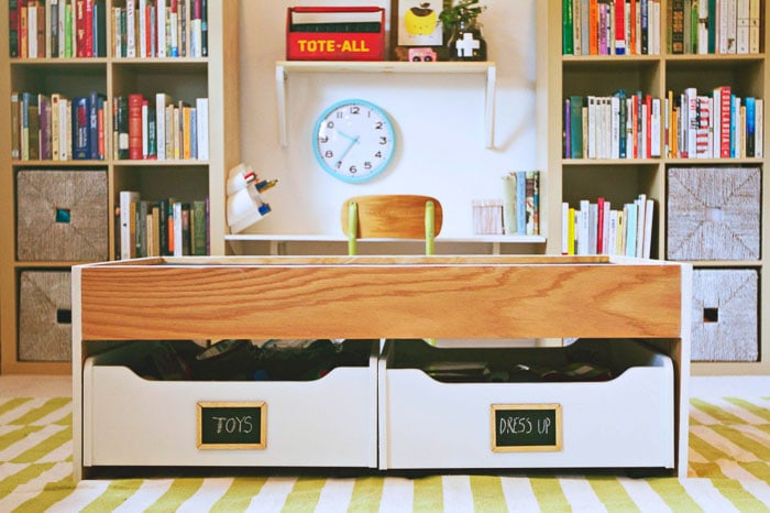 DIY train table with storage in a playroom