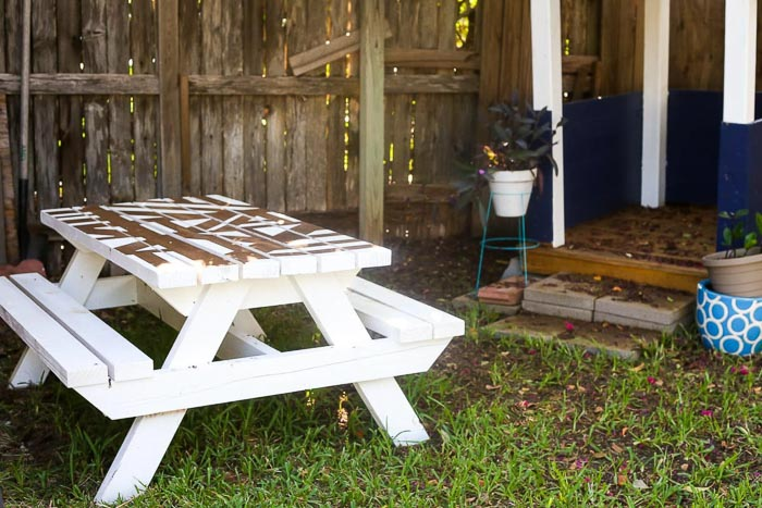 DIY Kids picnic table with geometric pattern in backyard
