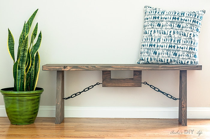 Easy DIY industrial farmhouse bench with throw pillow