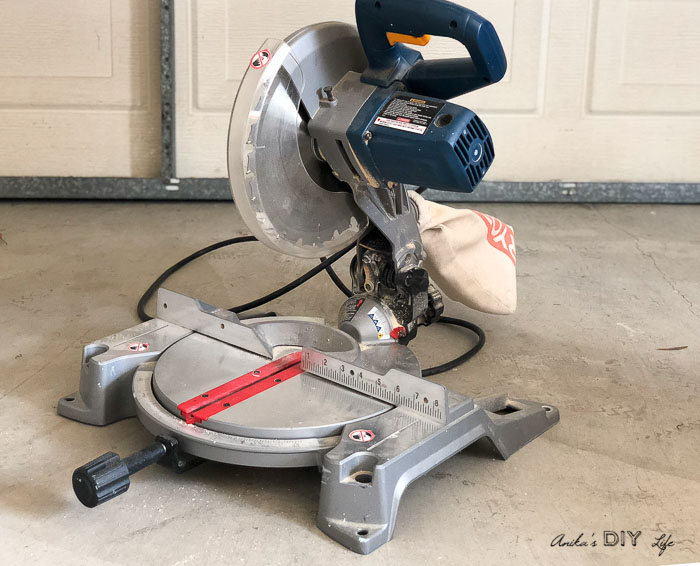 Compound miter saw on workshop floor