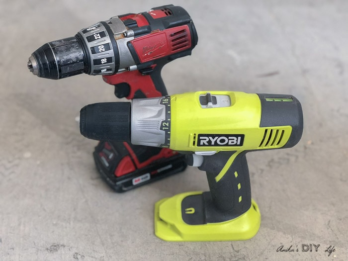Two cordless drill on workshop floor