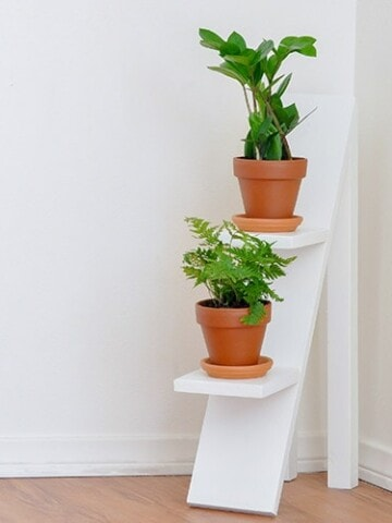 Build an easy DIY tiered plant stand with this step by step tutorial. The best part - uses scrap wood! Can be used indoors or outdoors!