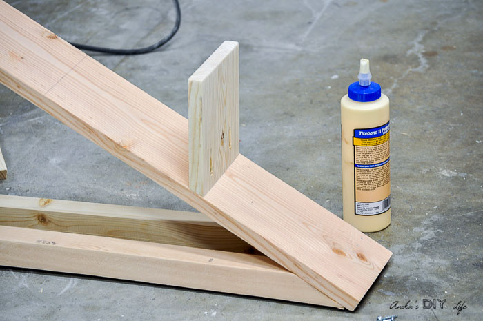 attaching shelves to the DIY plant stand