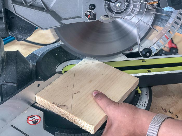 Cutting DIY Christmas village houses out of scrap wood on the miter saw