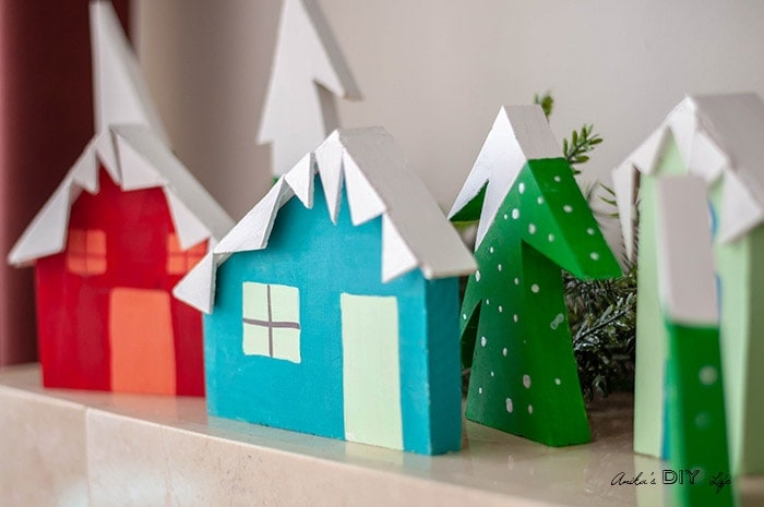 DIY Christmas village using scrap wood. This bright and happy Christmas village display is an eas