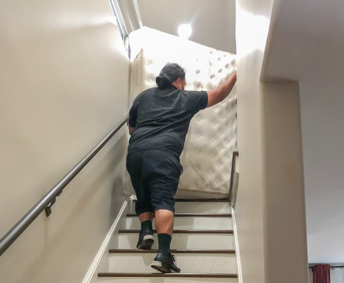 Saatva mattress delivery guys carrying it up the stairs