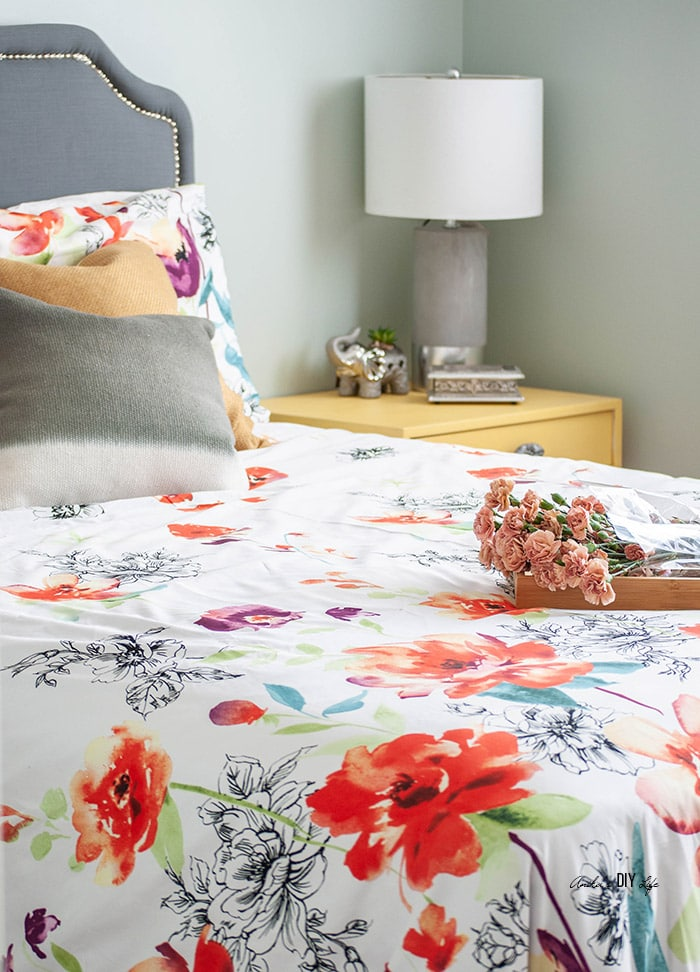 Colorful bedroom with flowers on it. Saatva mattress review