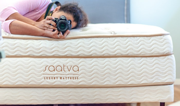 Saatva mattress review. girl laying on mattress