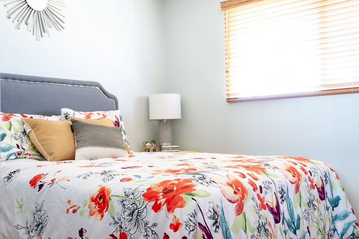 Room view with saatva mattress review and colorful bedspread