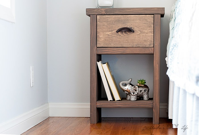 DIY nightstand with drawer and hidden compartment next to bed