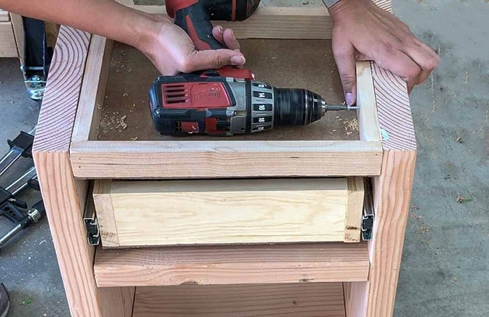 attaching secret compartment to the DIY nightstand with drawer