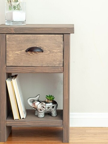 Learn how to build a DIY nightstand with hidden compartment and a drawer with the full step by step tutorial, video and plans. Easy beginner woodworking project using concealed joints!