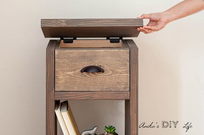 Hidden compartment by opening top in DIY nightstand