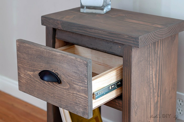 Open drawer in DIY nightstand with hidden storage