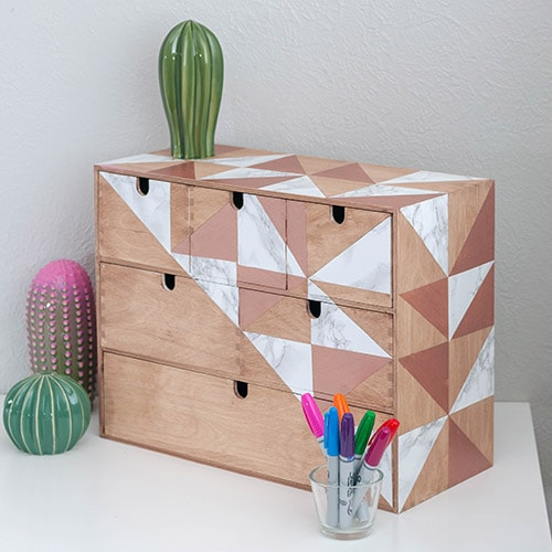 A gorgeous Ikea Moppe makeover in warm wood tones, rose gold and marble. Create a pretty and perfect organization with this marble contact paper project.