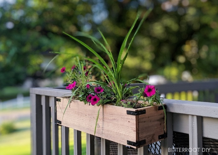 wood planter box attached to deck rail