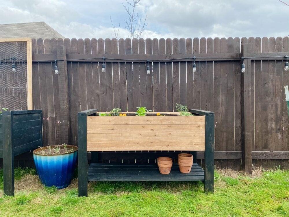 raised wood planter box with storage shelf