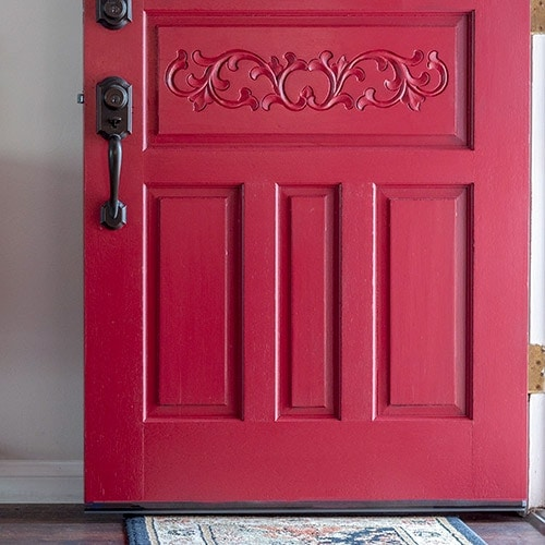 A step-by-step tutorial and supplies list to show you how to paint a front door the quick and easy way without removing it from the hinges.