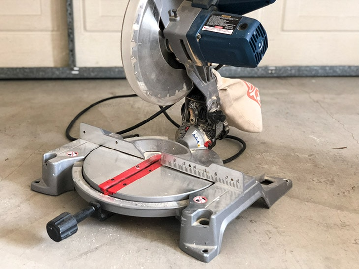 miter saw on garage floor