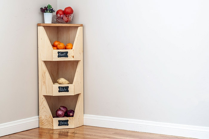 DIY corner vegetable bin with fruits and vegetables.