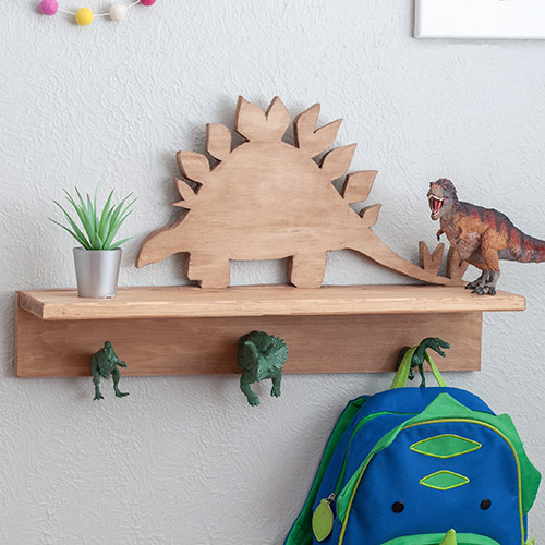 Dinosaur shelf with dinosaur hooks with small plant, T-rex and a bag