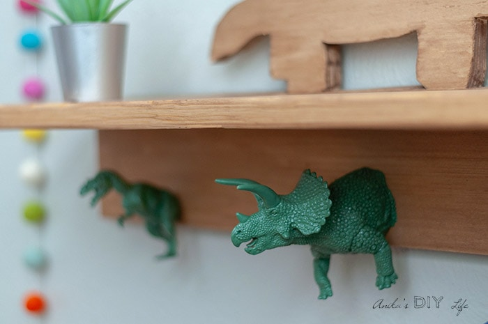 close up of dinosaur hooks on the dinosaur shelf