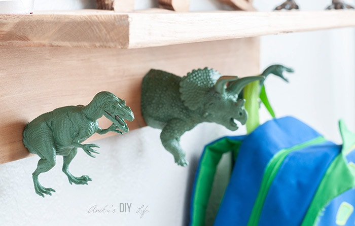 close up of DIY dinosaur shelf hooks