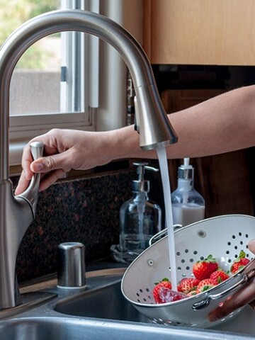 A step by step beginner's guide for how to replace a kitchen faucet. Learn how to change a kitchen faucet easily yourself and save money too!