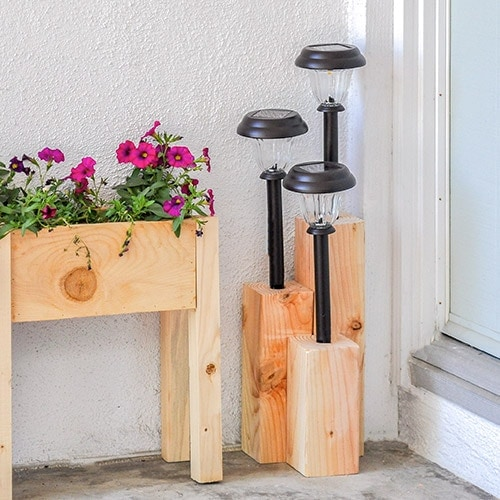 Learn how to make an inexpensive DIY solar light post to decorate your front yard or backyard. This quick project uses a board of 4x4 and a solar lamps. Make it as large or small as you like!
