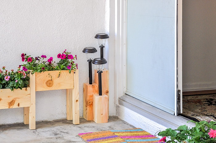 Front porch with DIY solar light stand and planter