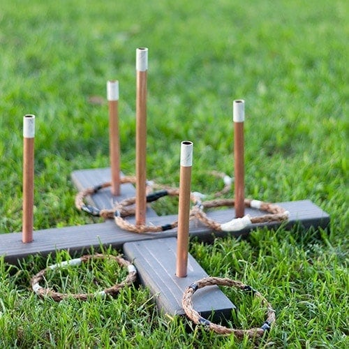 Simple DIY ring toss game with step by step tutorial. A classy take on the traditional carnival game that is easy to dismantle and store away when not in use.