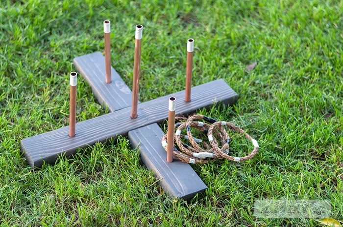 DIY Ring toss game in the grass with the rope rings