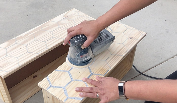 Sanding the engraved silver lines on the Ikea Rast drawer front