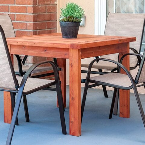 Learn how to make a simple DIY outdoor dining table with full plans, tutorial, and video. This DIY Outdoor table uses only structural 2x4 and 2x6 lumber and costs $20!