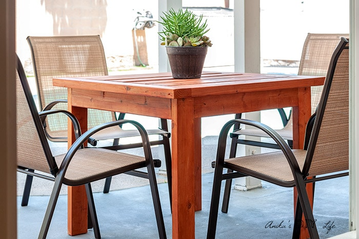 A Simple DIY outdoor dininh table in patio with 4 chairs