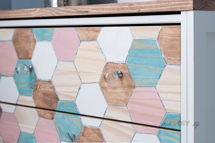 Close up of engraved Ikea Rast drawer with hexagon design