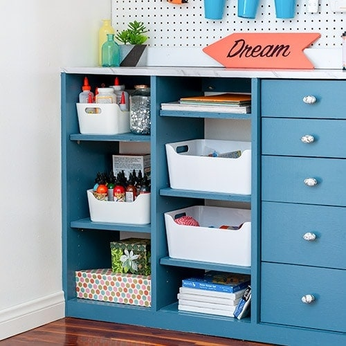 Learn how to build your own custom DIY craft closet organizer with drawers with these full plans, step by step tutorial and video. Turn any closet into the perfect organized craft closet.