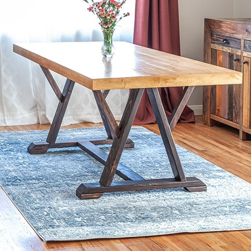 Learn how to build a DIY W-trestle dining table with full step by step tutorial and project video. Plus get the plans to build your own!