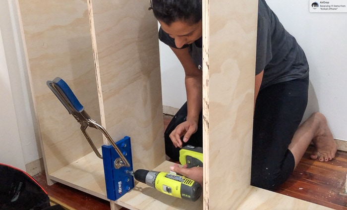 MAking shelf pin holes in the DIY craft organizer