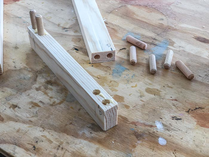 Dowel joinery on a workbench.
