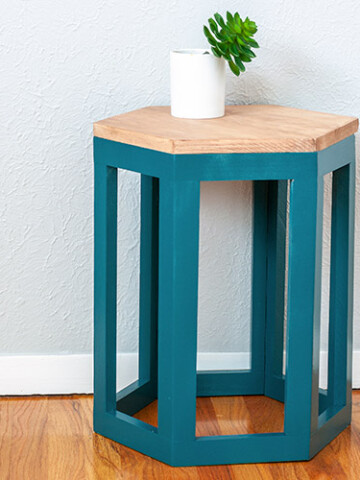 Learn how to build a DIY hexagon end table using a single 8 foot 1x10 board with step by step plans & video tutorial. OR build it using 1x2s - your choice!