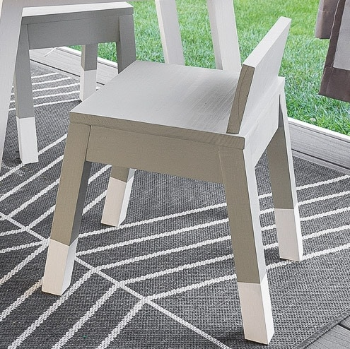 Learn how to build a simple modern angled leg DIY kids chair. The complete woodworking plans show you how to build this easy woodworking project for your toddler.