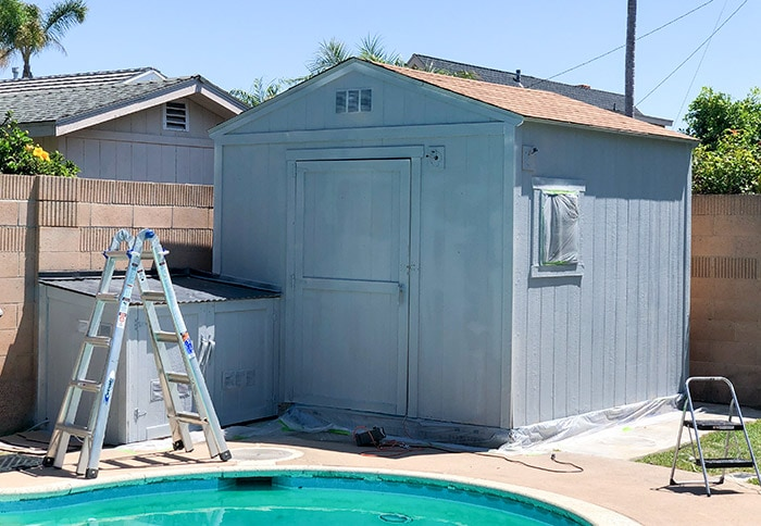 Outdoor Garden shed covered in grey primer.