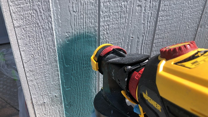 Apraying paint with paint sprayer but there is no overlap with the trim.