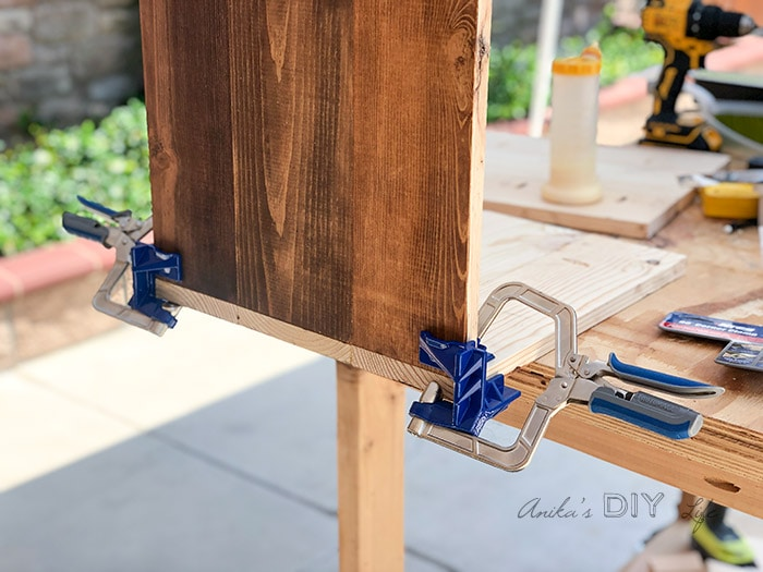 Using corner clamps to assemble a box for the nightstand