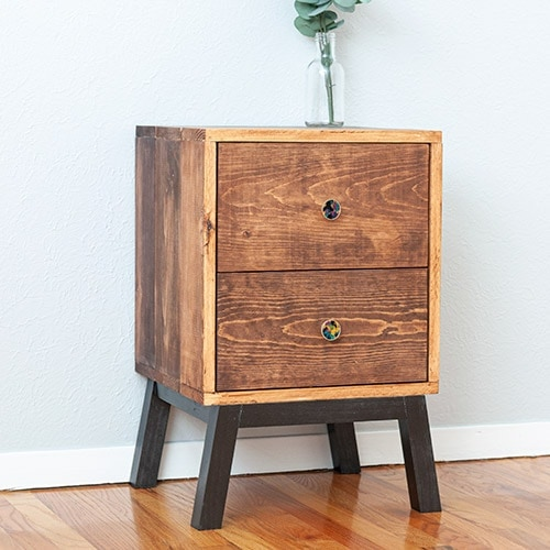 Learn how to make an easy DIY nightstand with drawers. A simple design perfect for beginners and looks like designer furniture! I have you covered with the full tutorial, plans and video!