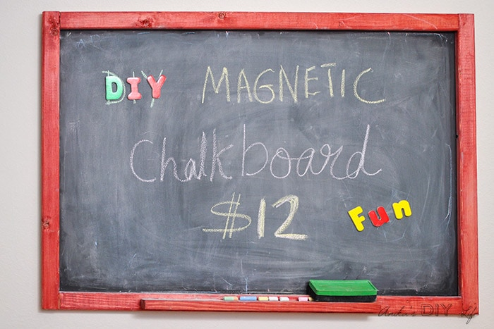 DIY magnetic chalkboard with red frame and characters written on it.